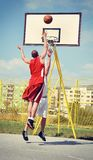 Two basketball players on the court Royalty Free Stock Images