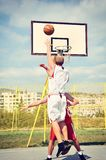 Two basketball players on the court Royalty Free Stock Image
