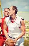 Two basketball players on the court Stock Photography