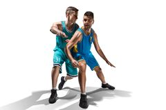 Two basketball players gameplay isolated on white. Background Royalty Free Stock Image