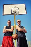 Two basketball players smiling on the court Royalty Free Stock Image