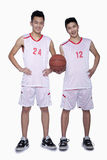 Two Basketball Players smiling, Studio Shot Stock Image