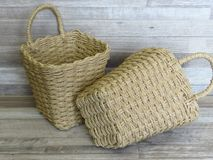 Two baskets made of straw, rattan, cane. Beautiful Handmade Woven Bamboo / Cane Basket. royalty free stock photo