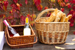 Two baskets with wine and bread Stock Images
