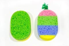 Two bath sponge  on white background. Stock Photos