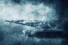 Two battle tanks moving in a snow storm Royalty Free Stock Photography