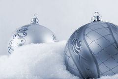 Two bauble laying on snow b&w Royalty Free Stock Photo