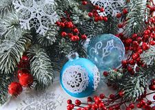 Two baubles with conifer and berries Stock Photo