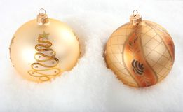 Two baubles  in snow Royalty Free Stock Photos