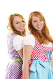 Two bavarian dressed girls. On white background Royalty Free Stock Photography