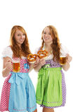 Two bavarian dressed girls with pretzels and beer. On white background Stock Images