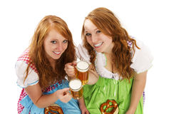 Two bavarian girls with beer and pretzels Royalty Free Stock Image