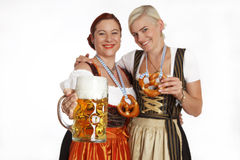 Two bavarian girls with beer in traditional costumes Stock Photography