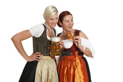 Two bavarian girls with beer in traditional costumes Stock Photo