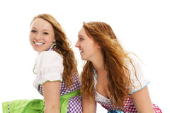 Two bavarian girls looking. On white background Stock Photo