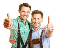 Two bavarian men holding thumbs up Royalty Free Stock Photos