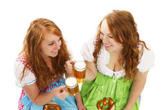 Two bavarian women with beer and pretzels. On white background Stock Photography