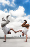 Two Bboy doing stunt at the roof stock photos