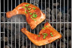 Two BBQ Roast Chicken Quarters On The Hot Charcoal Grill Royalty Free Stock Photo