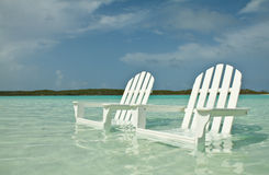 Two beach chairs. In the sea. Photo taken in Exumas, in one of the crystal clear lagoon of the the Bahamas Royalty Free Stock Image