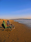 Two beach chairs. Two chairs by the shore on a beautiful day in Southern California Royalty Free Stock Photos
