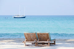 Two beach chairs and beautiful sand beach. And boat, Thailand Stock Image