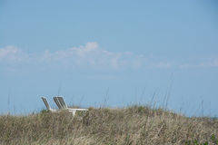 Two beach chairs in the dunes Royalty Free Stock Photography