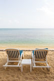 Two beach chairs at an empty beach in Thailand. Two beach chairs at the empty Maenam Beach in Koh Samui, Thailand Stock Photos
