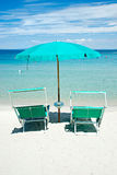 Two beach chairs with green umbrella. Two beach chairs with green umbrella on a white beach Stock Photography