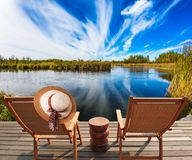 Two beach chairs and hat Stock Photography