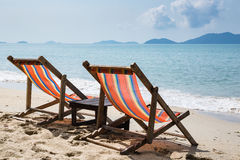 Two beach chairs on idyllic tropical beach. Two beach chairs on idyllic tropical sand beach Royalty Free Stock Image