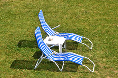Two beach chairs. On a lawn sunning area Stock Photo