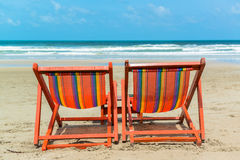 Two beach chairs. On the sand beach Royalty Free Stock Image