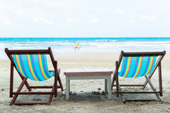 Two beach chairs. On the sand beach Stock Photos