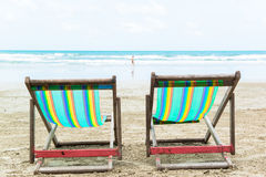 Two beach chairs. On the sand beach Royalty Free Stock Photo
