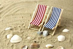 Two beach chairs on the sand Stock Photography