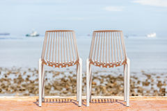 Two beach chairs and sea beach background. Concept for rest, rel. Axation and holiday Stock Photo