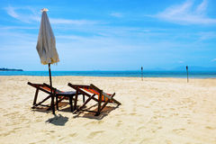 Two beach chairs on a tropical beach.  Royalty Free Stock Photography
