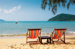 Two beach chairs on tropical beach. Stock Photography
