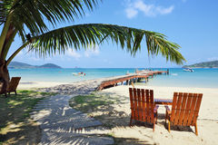 Two beach chairs on tropical beach. Two beach chairs on idyllic tropical sand beach Stock Photography