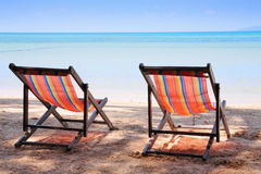 Two beach chairs on tropical sand beach. Two beach chairs on idyllic tropical sand beach Royalty Free Stock Image