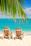 Two beach chairs on tropical shore.  Stock Photography