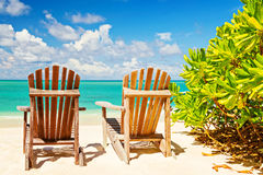 Two beach chairs on tropical shore, horizontal composition Royalty Free Stock Photo