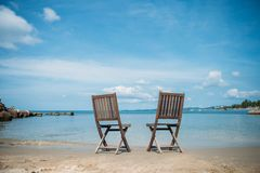 Two beach chairs on tropical shore. Phu Quoc Royalty Free Stock Photo