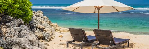 Two beach chairs on the tropical vacation BANNER, LONG FORMAT royalty free stock photo