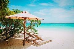 Two beach chairs on tropical vacation. Beach travel Royalty Free Stock Image