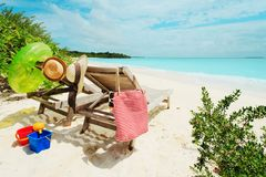 Two beach chairs on tropical vacation. Beach travel stock photography