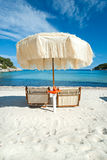 Two beach chairs with  umbrella. Royalty Free Stock Photos
