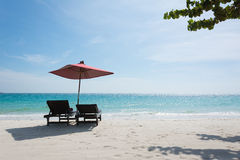 Two Beach chairs. With umbrella and beautiful sand beach Stock Photography