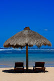 Two beach chairs under awning Stock Images